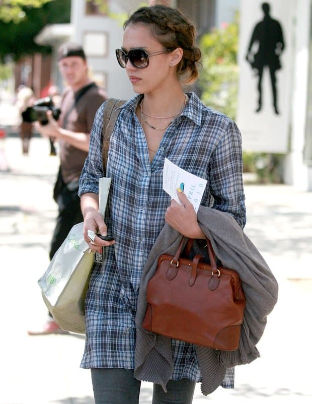 Jessica Alba leaving an office building in Brentwood with her hands full on April 13, 2010