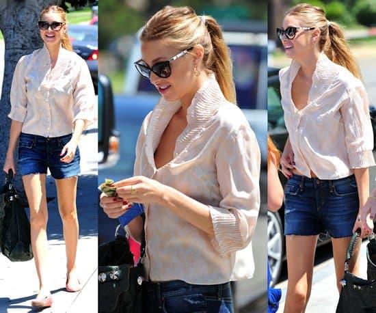 Whitney Port enjoys the sunshine wearing denim shorts