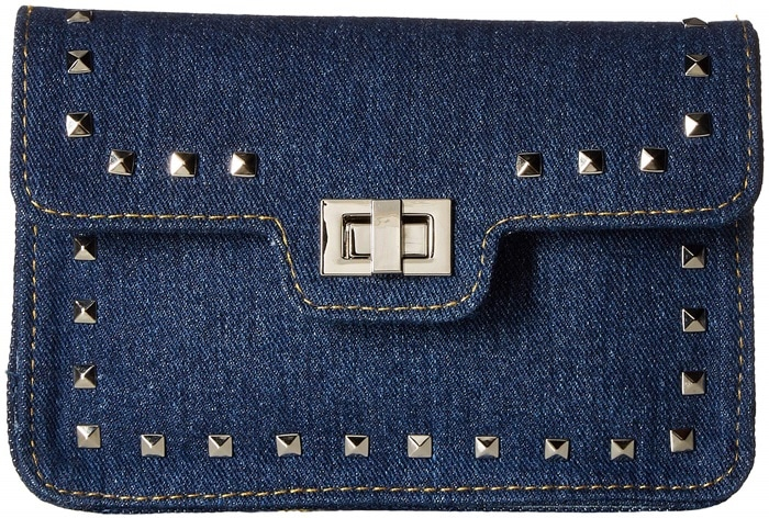 Polished pyramid studs and a statement guitar strap add rock 'n' roll edge to a festival-ready denim bag