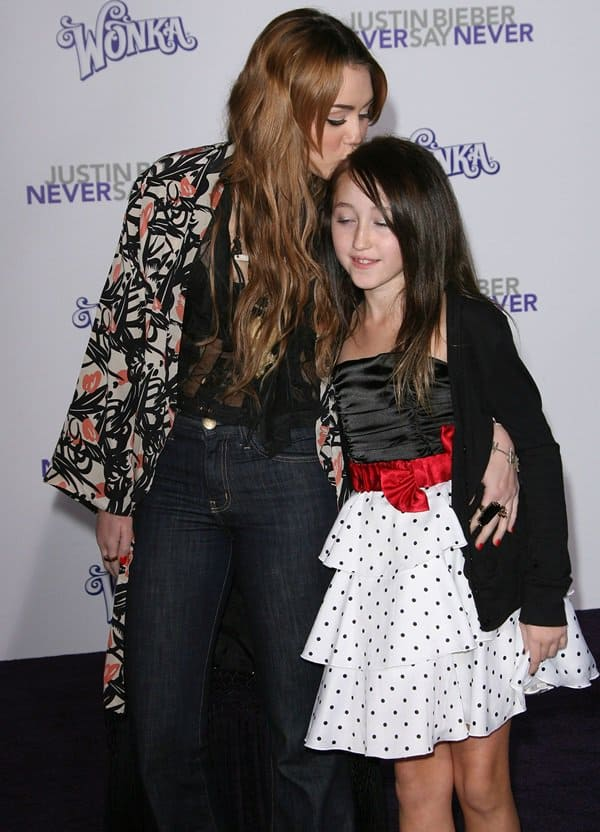 Miley Cyrus with her sister Noah at the Justin Bieber: Never Say Never premiere