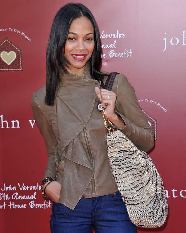 Zoe Saldana was cool and comfy in a Diane von Furstenberg brown draped front jacket and Decades Denim jeans