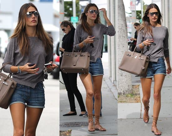 Alessandra Ambrosio wears high-waisted denim shorts