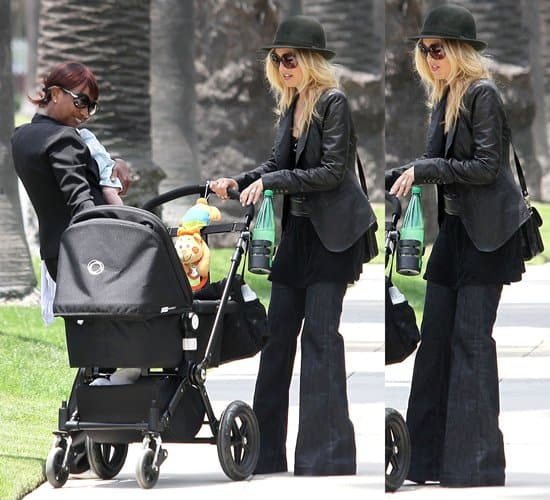 Rachel Zoe walking home with her son Skyler after getting frozen yogurt at a Pinkberry in Beverly Hills, California on May 23, 2011