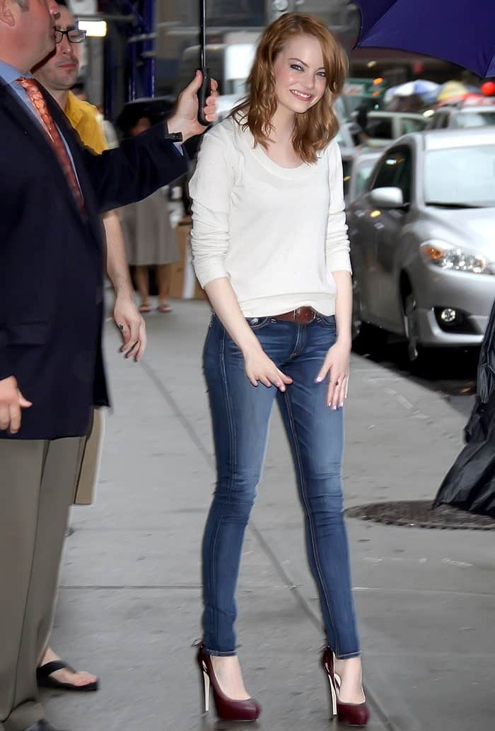 Emma Stone was cute and comfy in an off-white scoop-neck sweater, Brian Atwood Venus burgundy pumps, and Rag & Bone dark skinny jeans