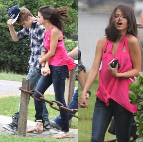 Selena Gomez styled a pink cutout top with dark blue jeans and white sandals
