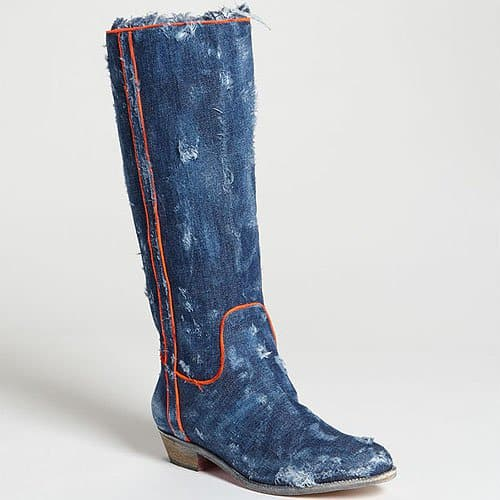 Distressed denim dominates a Western-cut boot finished with neon grosgrain for a noticeable jolt