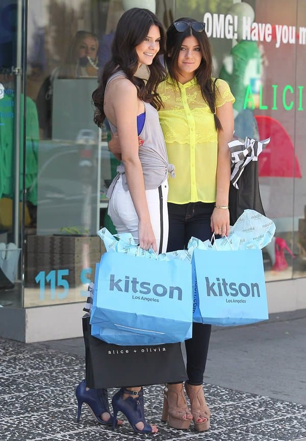 Kendall and Kylie Jenner were photographed on a promotional shopping spree at the Kitson boutique in Beverly Hills