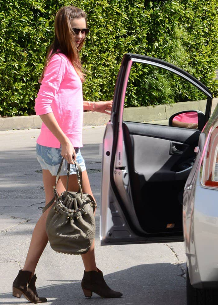 Miranda Kerr, in a pink top and denim shorts, leaving a friend's house in West Hollywood on April 2, 2012