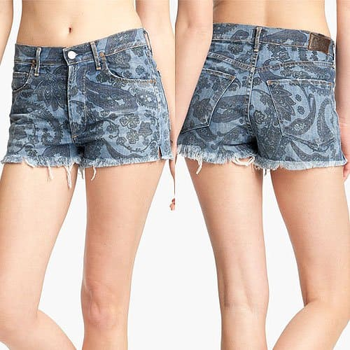 These printed high-waisted white denim shorts feature 5-pocket styling and a button fly