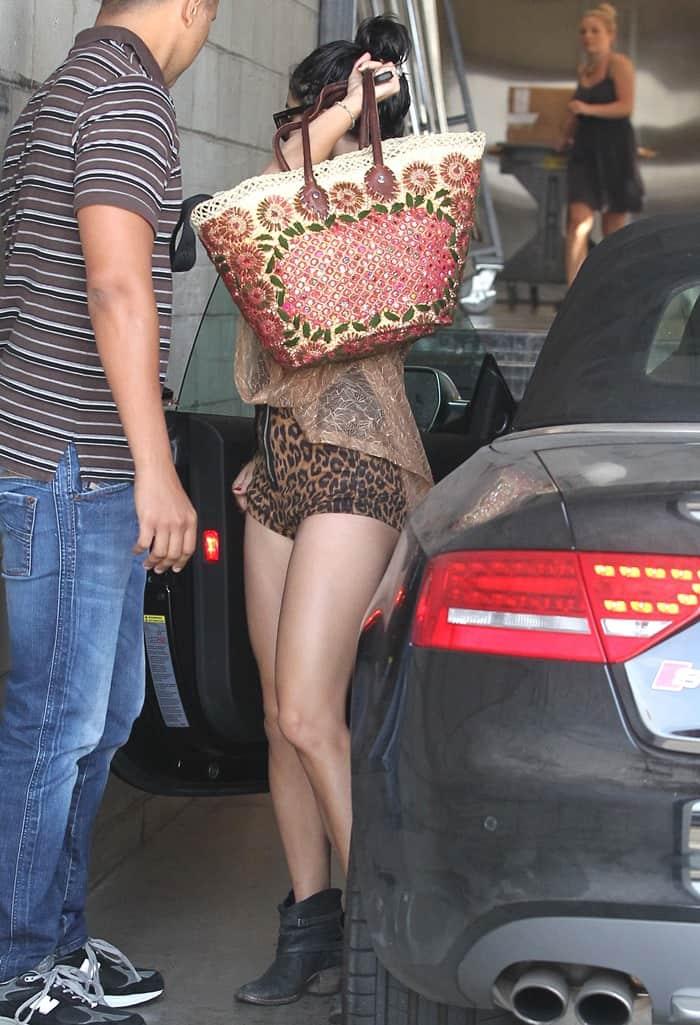 Vanessa Hudgens wearing cut-way-too-high leopard-print shorts