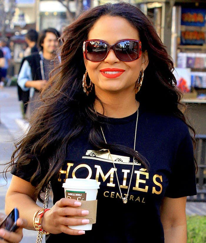 Actress Christina Milian sported a casual Brian Lichtenberg black tee with gold text print