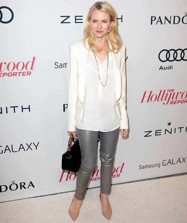 Naomie Watts kept things casual in a semi-sheer top covered with a white cropped tuxedo-style blazer