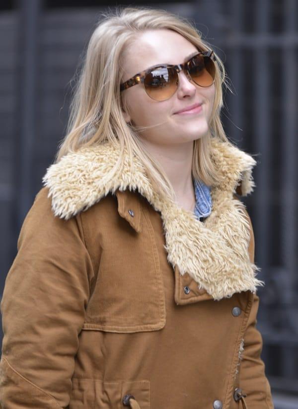 The Carrie Diaries star AnnaSophia Robb wears a heavy shearling coat in SoHo