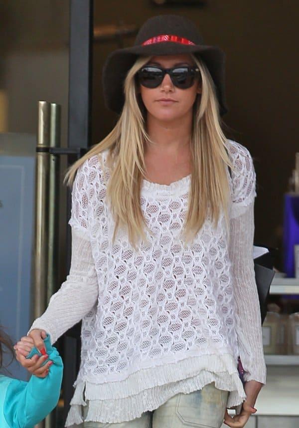 Ashley Tisdale shopping at Barneys New York