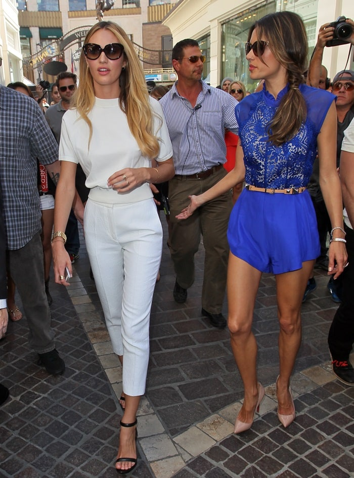 Victoria's Secret models Candice Swanepoel and Alessandra Ambrosio at The Grove to do an interview with Mario Lopez for the show EXTRA in Los Angeles, California on March 12, 2013