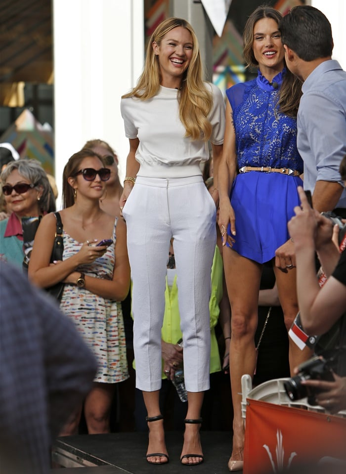 "Candice Swanepoel wearing a white T by Alexander Wang ""Illusion-Back"" shirt and white cropped pants"