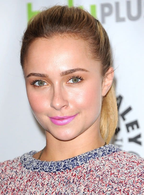 Hayden Panettiere with a neon pink lip color, a high ponytail, and golden shadow