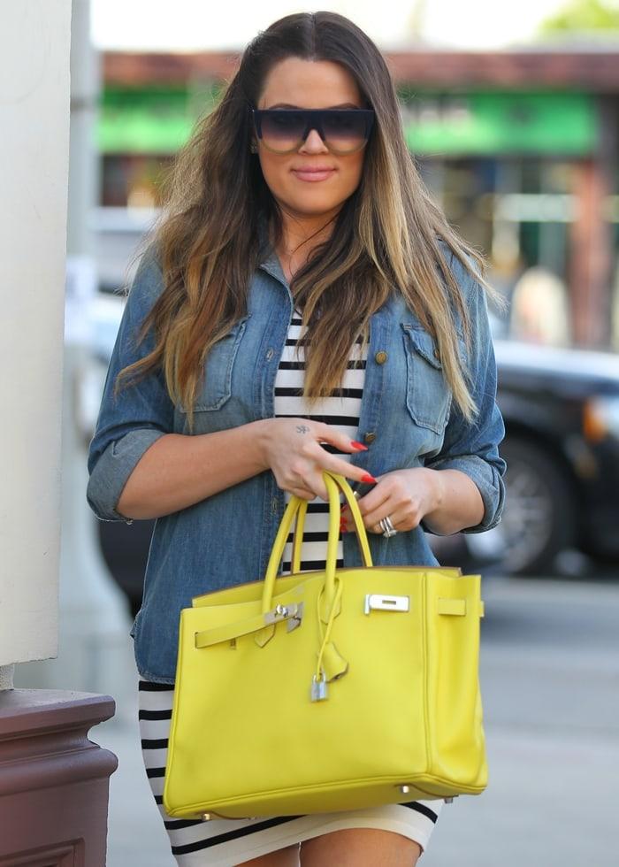 Khloe Kardashian totes a Hermes 35cm Candy Birkin bag in lime