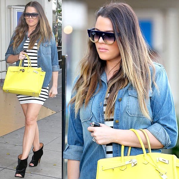 Khloe Kardashian wears a perfectly faded denim button-down while leaving On the Thirty restaurant