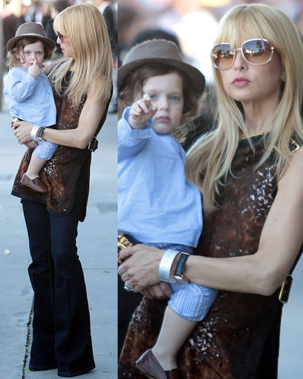 Rachel Zoe wearing flare jeans with a printed sleeveless top