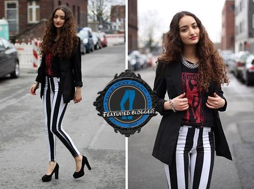 Ranim rocks a printed shirt with striped pants and a boyfriend blazer
