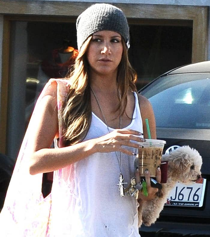 Ashley Tisdale with her dog, Maui, out on a coffee run in Studio City, California on April 16, 2013