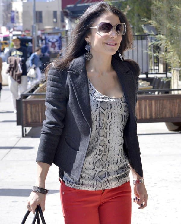 Bethenny Frankel styled red skinny jeans with a snakeskin-printed top