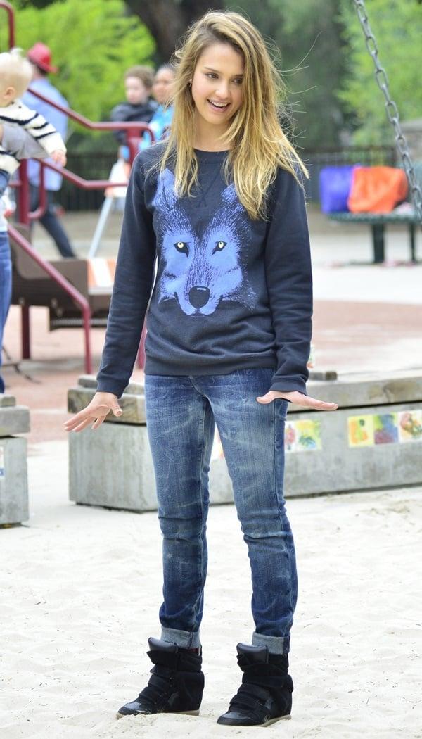 Jessica Alba's black sweatshirt featuring a wolf design