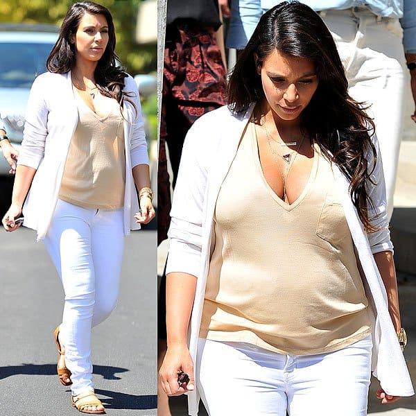 Kim Kardashian wearing white maternity jeans