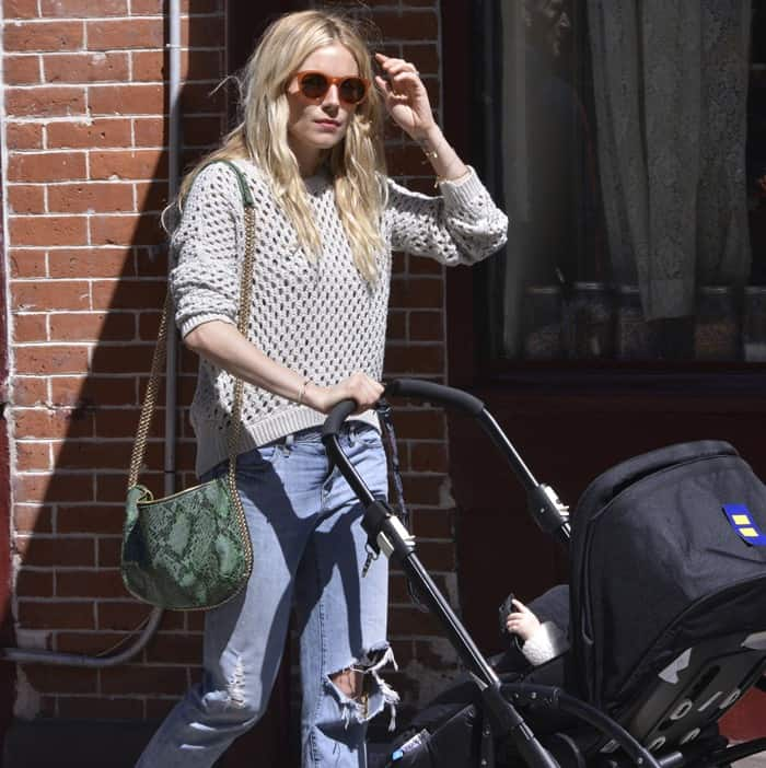 Sienna Miller and baby Marlowe are seen out for a walk
