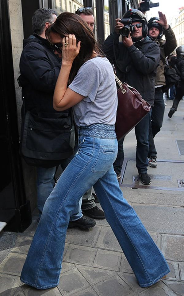 Victoria Beckham does some shopping at Eres before stopping at Hotel Costes