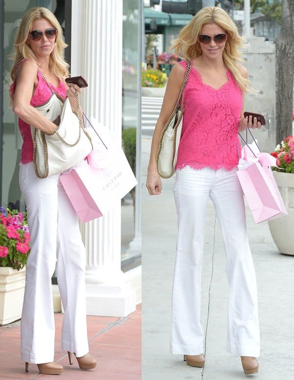 Brandi Glanville paired her white bootcut jeans with a pink lace top and beige heeled booties