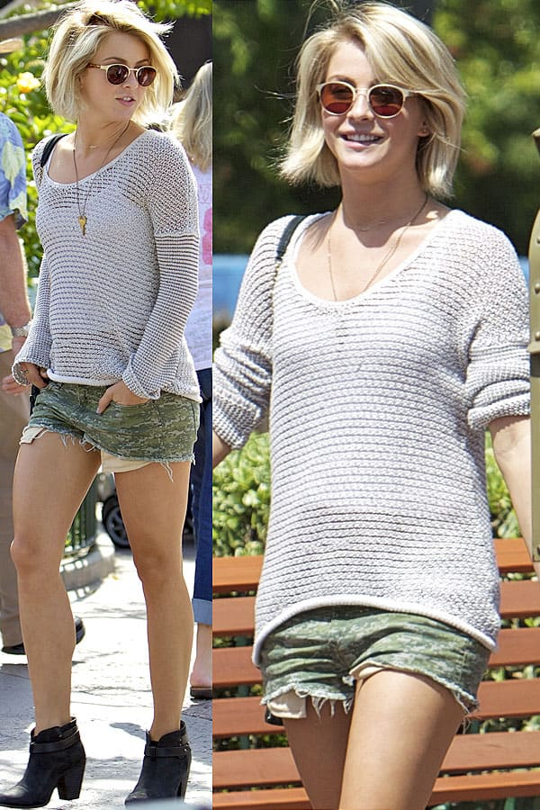 Julianne Hough wearing a knit top and camo cutoff shorts