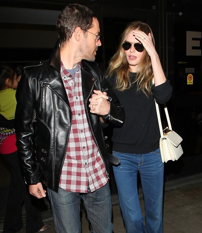 Kate Bosworth styled a black sweater with Mother flare jeans