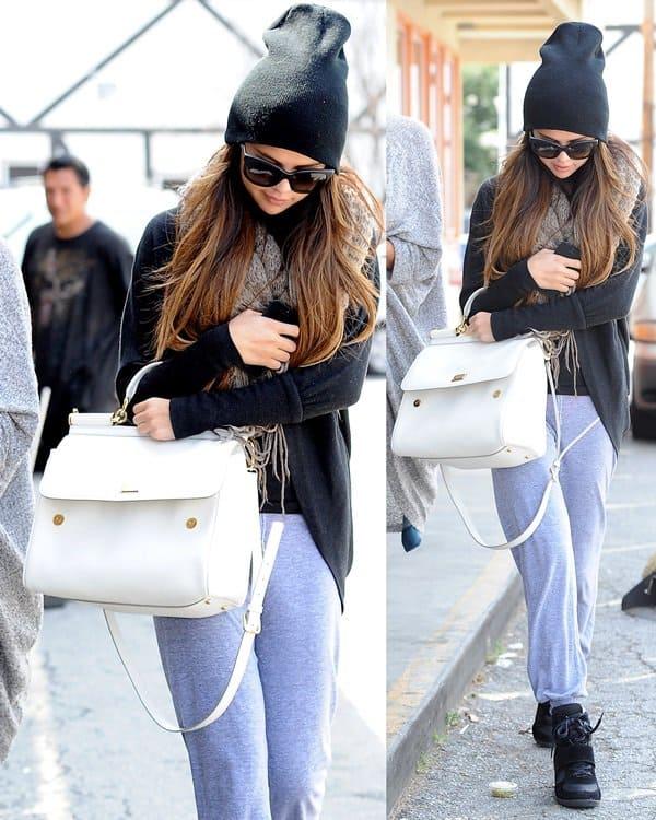 Selena Gomez rocks a Bdg Cooperative two-way scarf, sweatpants, Dolce & Gabbana Dg4149 sunglasses, and Top Moda Sammy 6 velcro high top sneakers