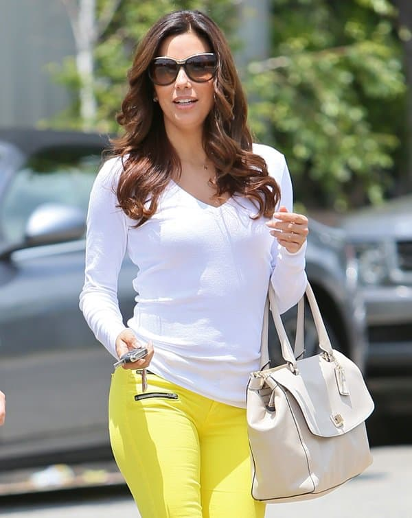 Eva Longoria is seen leaving the Ken Paves hair salon in good spirits after graduating with her master's degree from CalState Northridge University