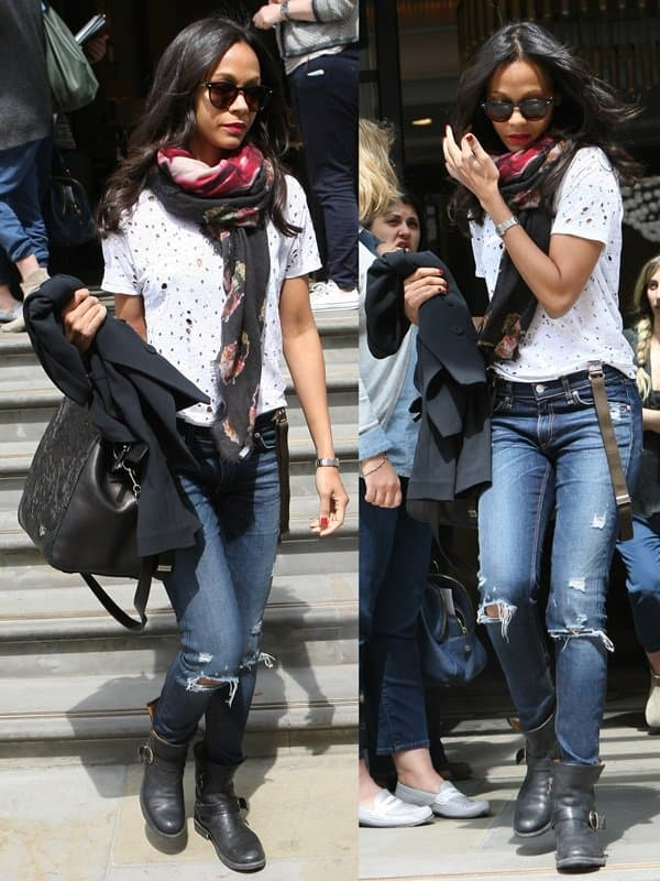 Zoe Saldana styled her dark-washed denim jeans with ankle boots