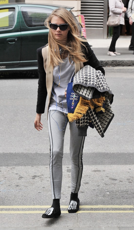 Cara Delevingne flaunts her legs in two-tone Topshop pipe panel leggings