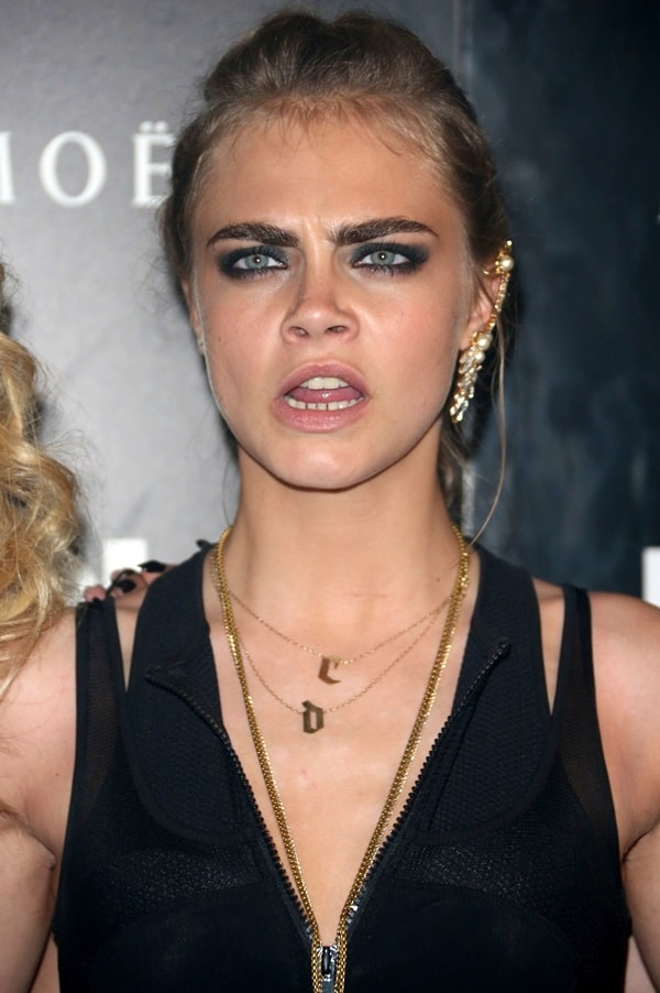 Cara Delevingne making funny face at the DKNY Artworks launch party held at a fire station in London, England on June 12, 2013