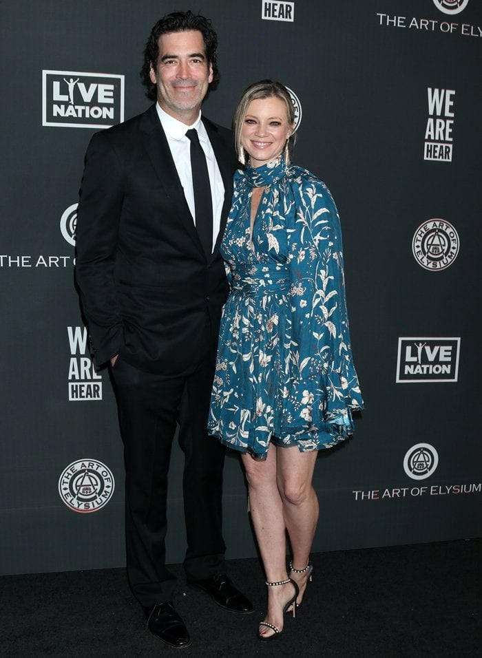 Carter Oosterhouse and his wife Amy Smart attend The Art Of Elysium Presents WE ARE HEAR'S HEAVEN 2020 at Hollywood Palladium