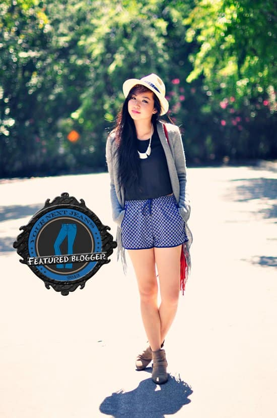 Fizz flaunts her legs in track shorts with a cardigan, ankle boots, and a fedora hat