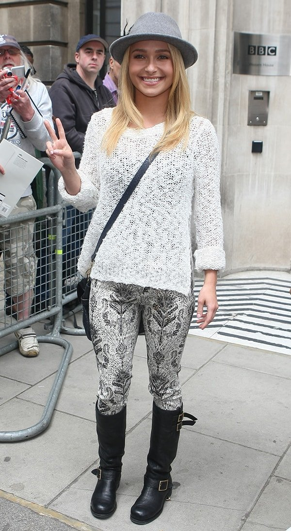 Hayden Panettiere wearing a knitted top and a pair of jeans, which she tucked in her riding boots