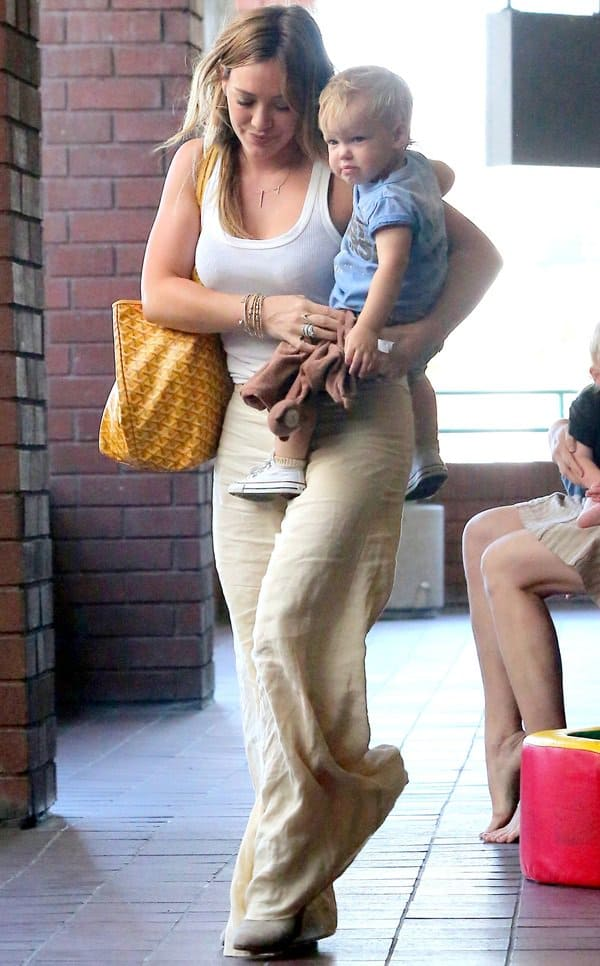 Hilary Duff sported a very summer-perfect ensemble consisting of a plain white tank top and a pair of breezy linen pants