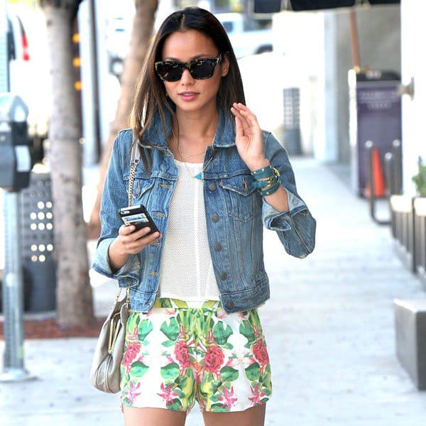 Jamie Chung shows how to wear floral shorts with a breezy white top and a denim jacket