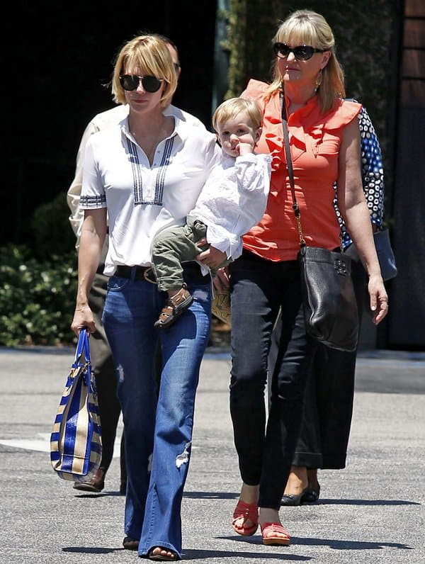 January Jones wearing flared jeans to lunch at Houston's with son Xander and mother Karen