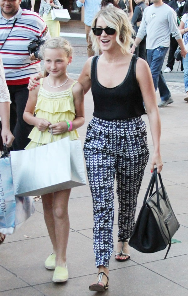 Julianne Hough in a black tank top paired with printed slouchy pants goes shopping with her niece Skye