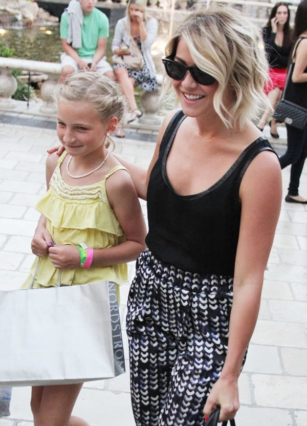 Julianne Hough wearing printed slouchy pants with a black tank top