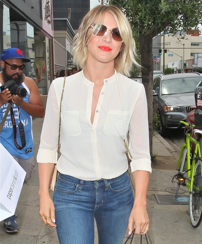 Julianne Hough wears classic skinny jeans with a white button-down top