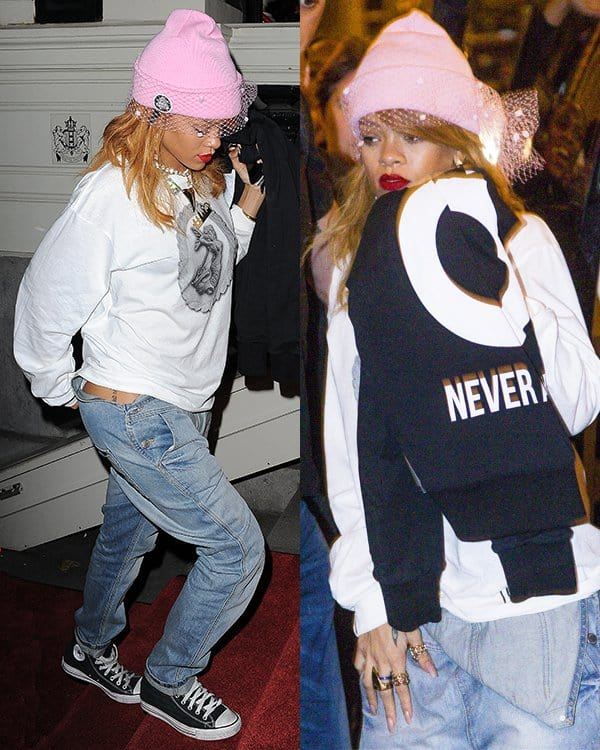 Rihanna sported overalls worn half-down like a pair of jeans paired with an oversized sweater