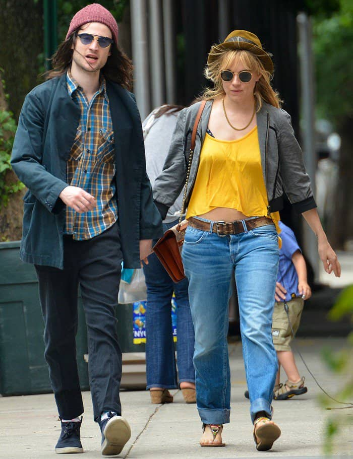 Sienna Miller rocked a pair of boyfriend jeans in faded denim when she went out for breakfast with her fiancé, Tom Sturridge
